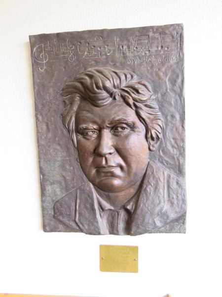 Jacob Nævdal  - Relieff av spelemannen Sjur Helgeland  (1858-1924).